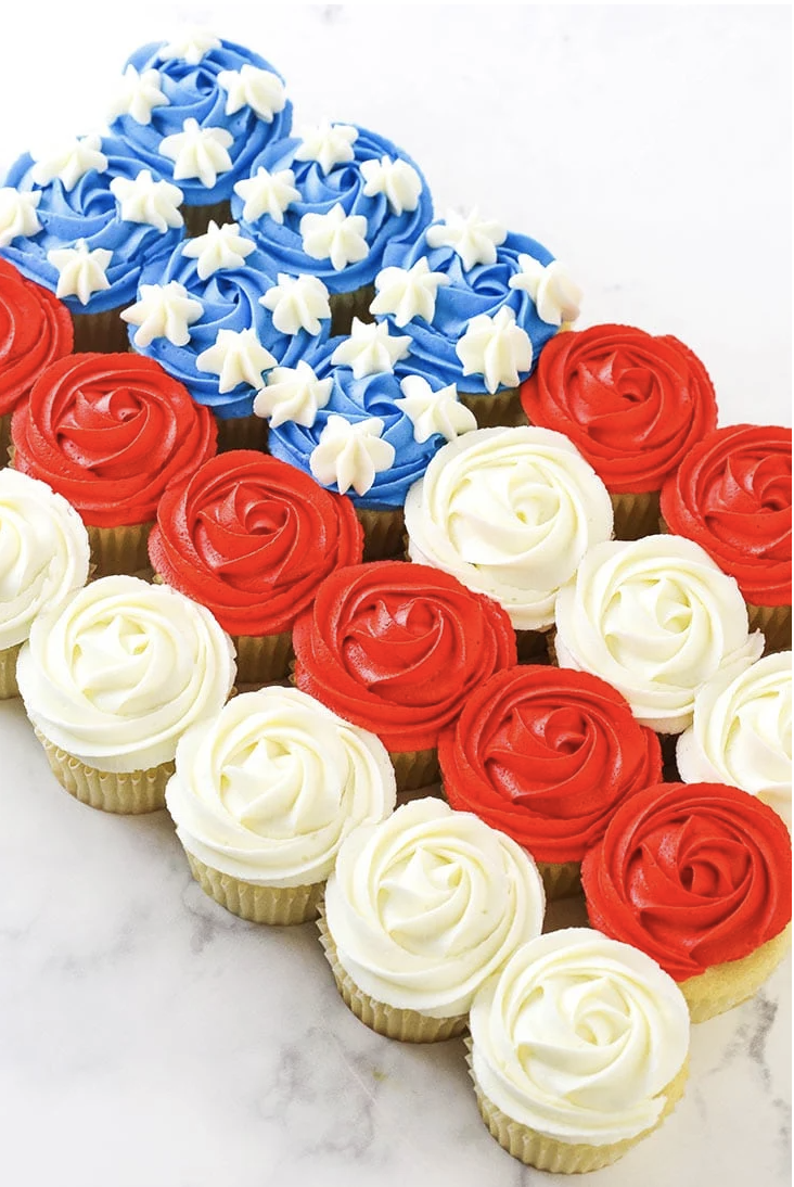 """<p>A classic <a href=""""https://www.goodhousekeeping.com/holidays/g32446340/fourth-of-july-cake-ideas/"""" rel=""""nofollow noopener"""" target=""""_blank"""" data-ylk=""""slk:4th of July cake"""" class=""""link rapid-noclick-resp"""">4th of July cake</a> is great, but turning it into cupcakes make it easier to share!</p><p><em><a href=""""https://www.lifeloveandsugar.com/american-flag-cupcake-cake/"""" rel=""""nofollow noopener"""" target=""""_blank"""" data-ylk=""""slk:Get the recipe from Life, Love & Sugar »"""" class=""""link rapid-noclick-resp"""">Get the recipe from Life, Love & Sugar »</a></em></p>"""