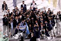 <p>TOKYO, JAPAN - JULY 23: Team Argentina pose for a photo during the Opening Ceremony of the Tokyo 2020 Olympic Games at Olympic Stadium on July 23, 2021 in Tokyo, Japan. (Photo by Patrick Smith/Getty Images)</p>