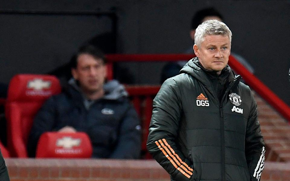 Manchester United's manager Ole Gunnar Solskjaer reacts during the English Premier League soccer match - AP