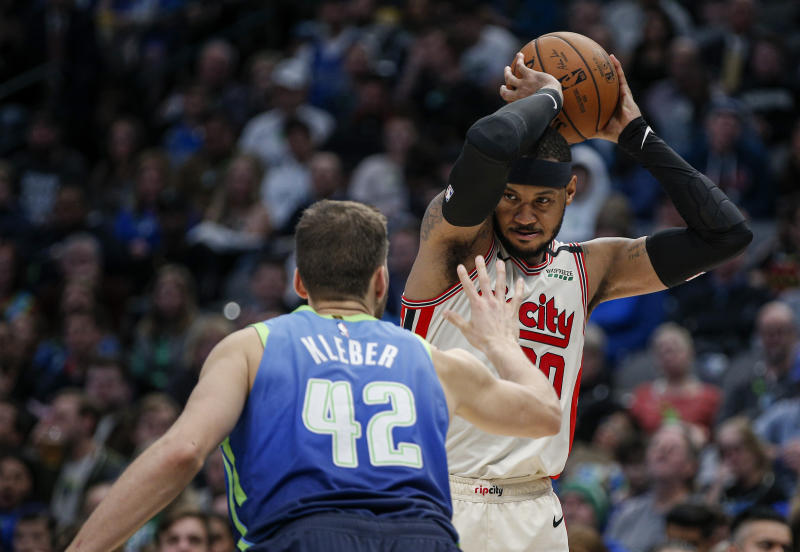 Portland Trail Blazers forward Carmelo Anthony (00) is defended by Dallas Mavericks forward Maxi Kleber (42) during the second half of an NBA basketball game Friday, Jan. 17, 2020, in Dallas. Dallas won 120-112. (AP Photo/Brandon Wade)