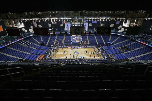 Greensboro Coliseum is mostly empty after the NCAA college basketball games were cancelled at the Atlantic Coast Conference tournament in Greensboro, N.C., Thursday, March 12, 2020. The biggest conferences in college sports all canceled their basketball tournaments because of the new coronavirus, seemingly putting the NCAA Tournament in doubt. (AP Photo/Gerry Broome)