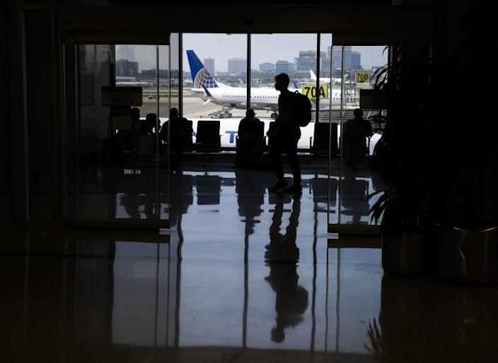 """Los Angeles, CA - May 28: Amid a busy getaway travel day for the Memorial Day weekend and the first holiday since coronavirus pandemic restrictions have been relaxed, travelers make their way to their destinations at LAX, United Airlines, Terminal 7 in Los Angeles Friday, May 28, 2021. Officials say travelers should arrive early for Memorial Day weekend flights. After months of Los Angeles International Airport looking like a ghost town, holiday crowds are back. """"We're seeing more travelers than we've seen in the last 14 months. We had over 75,000 people come through on Sunday alone to the TSA checkpoints, that's by far a record in 2021 for us,"""" said LAX spokesperson Keith Montgomery. Photo taken in LAX on Friday, May 28, 2021 in Los Angeles, CA. (Allen J. Schaben / Los Angeles Times)"""