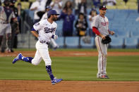 Los Angeles Dodgers' Chris Taylor, left, runs by Washington Nationals first baseman Ryan Zimmerman after hitting a three-run home run during the second inning of a baseball game Saturday, April 10, 2021, in Los Angeles. (AP Photo/Mark J. Terrill)