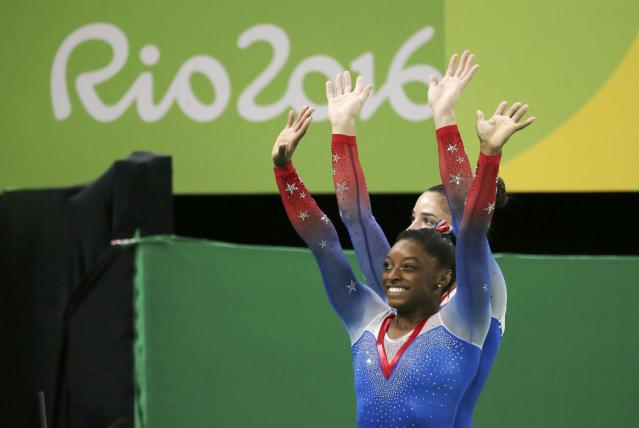 2016 Rio Olympics - Artistic Gymnastics - Final - Women's Floor Final - Rio Olympic Arena - Rio de Janeiro, Brazil - 16/08/2016. Simone Biles (USA) of USA (front) and Alexandra Raisman (USA) of USA (Aly Raisman) celebrate winning the gold and the silver respectively. REUTERS/Ruben Sprich FOR EDITORIAL USE ONLY. NOT FOR SALE FOR MARKETING OR ADVERTISING CAMPAIGNS.