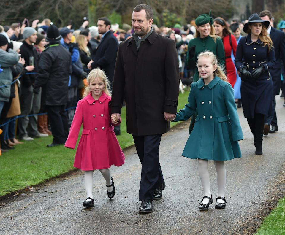 Peter with his daughters Isla, left, and Savannah, right, at the Christmas Day service at Sandringham (PA Archive/PA Images)