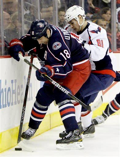 Washington Capitals' Dmitry Orlov (81), of Russia, and Columbus Blue Jackets' R.J. Umberger (18) fight for a loose puck during the second period of an NHL hockey game, Saturday, Dec. 31, 2011, in Columbus, Ohio. (AP Photo/Jay LaPrete)