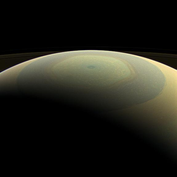 The globe of Saturn, seen here in natural color, is reminiscent of a holiday ornament in this wide-angle view from NASA's Cassini spacecraft. The characteristic hexagonal shape of Saturn's northern jet stream, somewhat yellow here, is visible.