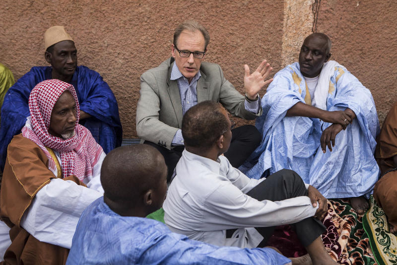 In this Nov. 3, 2017, photo provided by the United Nations, Andrew Gilmour, center, assistant secretary-general for human rights, meets with Peul religious leaders from Mopti to discuss human rights issues and the security situation in the region in Mali. Gilmour says the past decade has seen backlash on human rights on every front, especially on the rights of women and the LGBT communities. (Harandane Dicko/United Nations via AP)