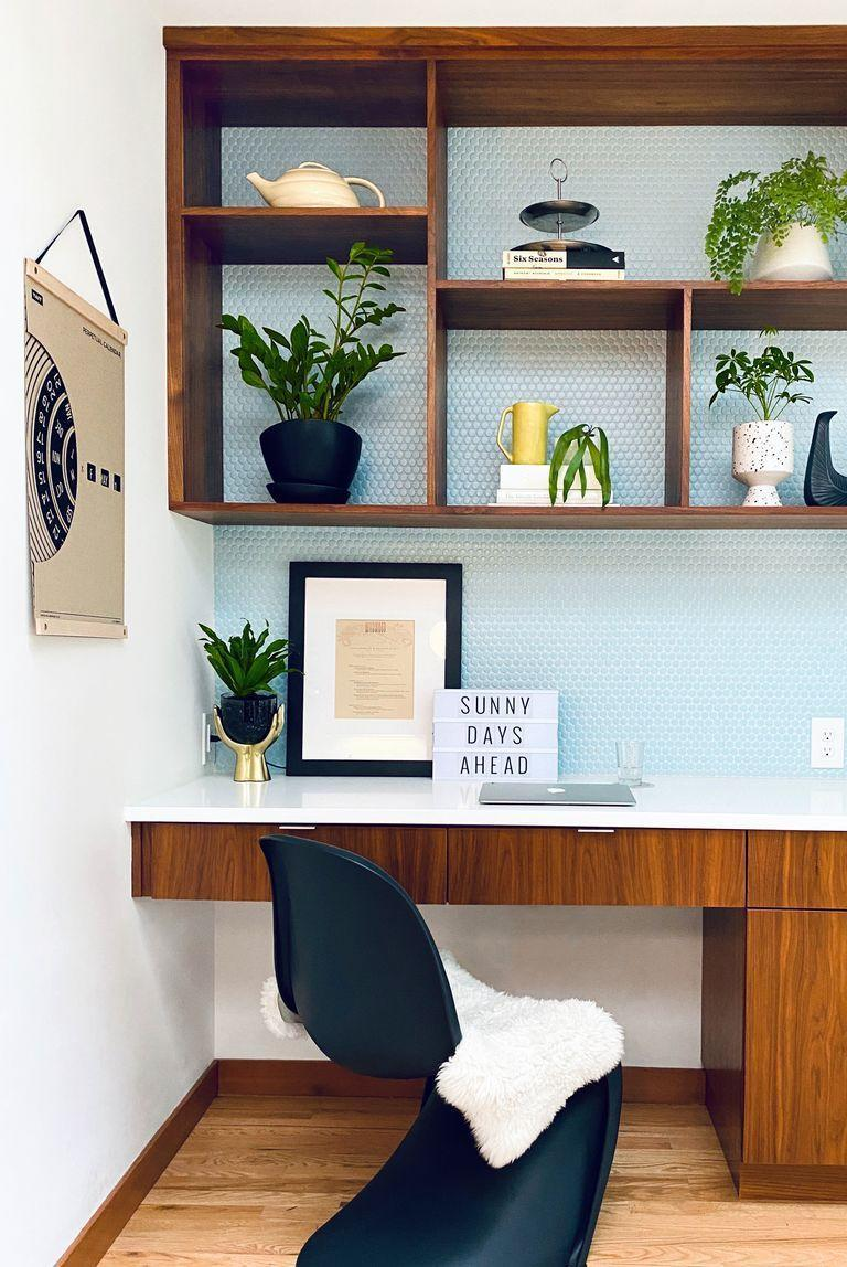 <p>If you're unable to dedicate an entire room to your office, carve out a space right in your kitchen. That's just what Heather Keeling of Portland, OR, did. She created a cozy, contemporary workspace with baby-blue penny tile and sleek custom shelving. </p>