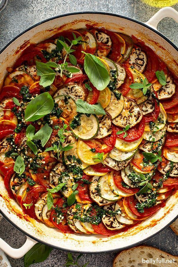 """<p>This rich stewed veggie dish is an ideal Thanksgiving side: It can be made easily ahead of time, and easily brightens any plate.</p><p><strong>Get the recipe at <a href=""""https://bellyfull.net/ratatouille-recipe/"""" rel=""""nofollow noopener"""" target=""""_blank"""" data-ylk=""""slk:Belly Full"""" class=""""link rapid-noclick-resp"""">Belly Full</a>.</strong></p><p><strong><a class=""""link rapid-noclick-resp"""" href=""""https://www.amazon.com/Crock-111982-01-Artisan-Enameled-Skillet/dp/B072QFW3XK/?tag=syn-yahoo-20&ascsubtag=%5Bartid%7C10050.g.33501494%5Bsrc%7Cyahoo-us"""" rel=""""nofollow noopener"""" target=""""_blank"""" data-ylk=""""slk:SHOP CAST IRON PANS"""">SHOP CAST IRON PANS</a><br></strong></p>"""