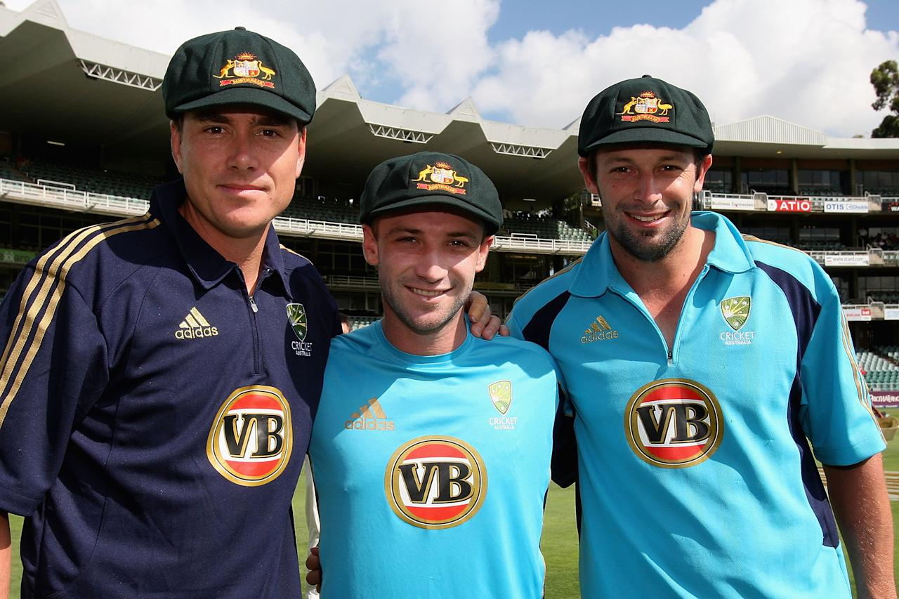 JOHANNESBURG, SOUTH AFRICA - FEBRUARY 26:  Debutants (L - R) Marcus North, Phil Hughes and Ben Hilfenhaus of Australia after being presented with their Baggy Green Caps ahead of day one of the First Test between South Africa and Australia played at the Wanderers on February 26, 2009 in Johannesburg, South Africa.  (Photo by Hamish Blair/Getty Images)