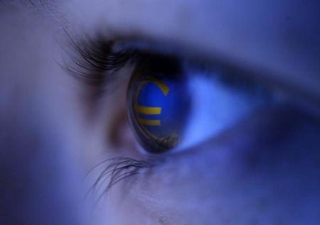Picture illustration shows the Euro currency logo reflected in a person's eye, in central Bosnian town of Zenica