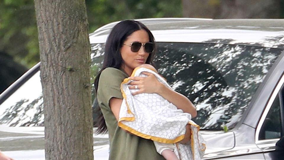 Meghan Markle holds baby Archie