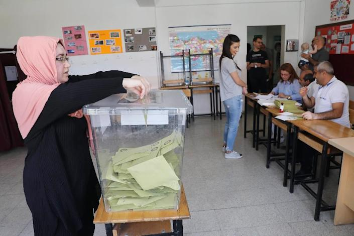 Over 56 million eligible voters were for the first time casting ballots in both parliamentary and presidential polls (AFP Photo/ADEM ALTAN)