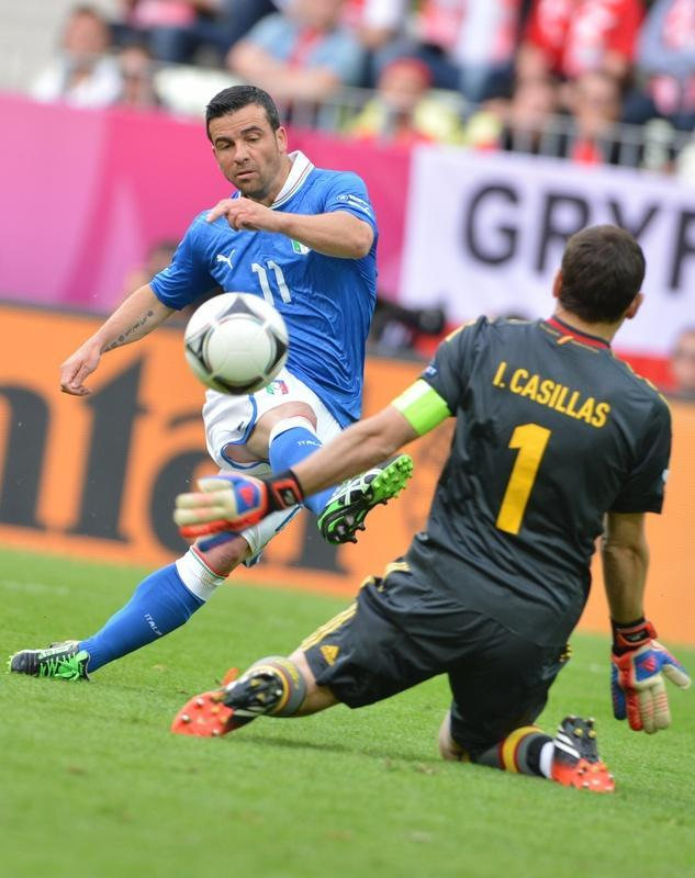 Italian forward Antonio Di Natale (L) scores past Spanish goalkeeper Iker Casillas during the Euro 2012 championships football match Spain vs Italy on June 10, 2012 at the Gdansk Arena. AFPPHOTO/ GIUSEPPE CACACEGIUSEPPE CACACE/AFP/GettyImages