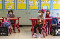 Students sit in a distanced pattern from their classmates during the coronavirus outbreak in a Kindergarten class at School 16, Tuesday, Oct. 20, 2020, in Yonkers, N.Y. (AP Photo/Mary Altaffer)