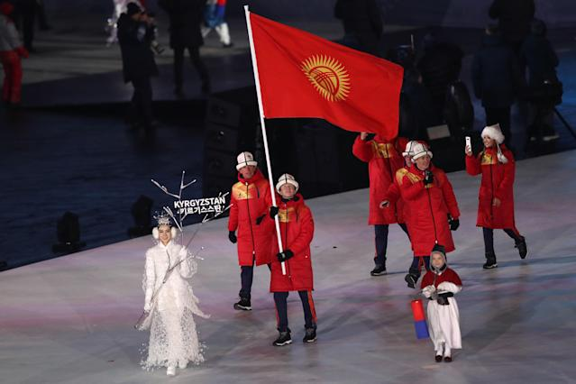 <p>Flag bearer Tariel Zharkymbaev of Kyrgyzstan leads the team during the Opening Ceremony of the PyeongChang 2018 Winter Olympic Games at PyeongChang Olympic Stadium on February 9, 2018 in Pyeongchang-gun, South Korea. (Photo by Ronald Martinez/Getty Images) </p>