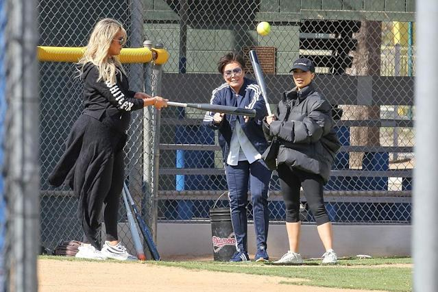 <p>Play ball! The sisters and their mom were seen playing softball while filming a new episode of <em>Keeping Up With the Kardashians</em> on Tuesday. Kris tossed a few pitches to Kim, who did her best to hit the ball. Pregnant Khloé played for a bit but stood mostly on the sidelines taking care of her bump. (Photo: Bahe/BackGrid)<br><br></p>