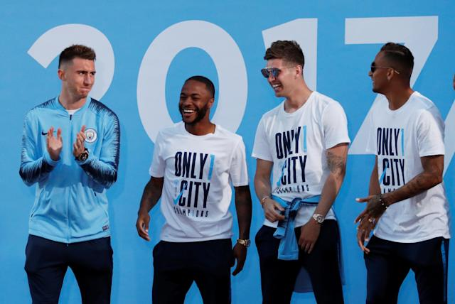 Soccer Football - Premier League - Manchester City Premier League Title Winners Parade - Manchester, Britain - May 14, 2018 Manchester City's Aymeric Laporte, Raheem Sterling and John Stones on stage during the parade Action Images via Reuters/Andrew Boyers