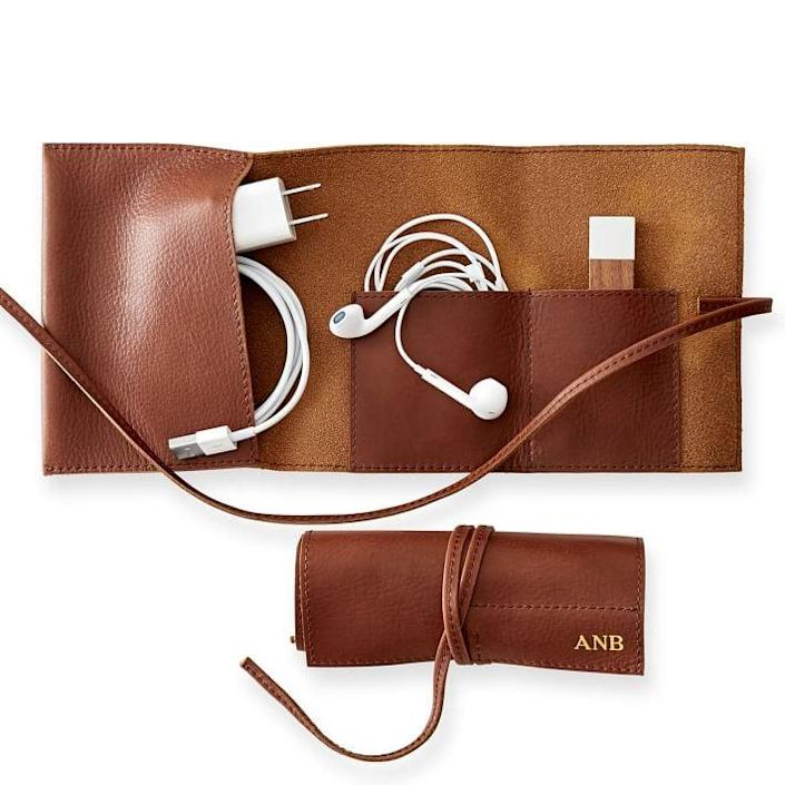 <p>The <span>Mark &amp; Graham Leather Charger Roll-Up</span> ($39, originally $49) is a functional yet personal item that allows you to avoid having a tangle of cords mucking about in the bottom of your bag - so it's basically the perfect gift for that one person everyone knows who just <em>cannot</em> keep their iPhone headphones untangled.</p>