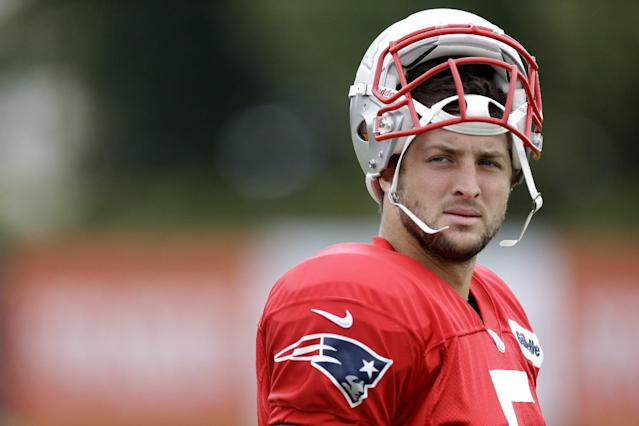 FILE - In this Aug. 7, 2013, file photo, New England Patriots' Tim Tebow walks onto the field during a joint workout with the Philadelphia Eagles at NFL football training camp in Philadelphia. Tebow says he is not done with the NFL even though helping ESPN launch the SEC Network was too good an opportunity to pass up. Tebow stresses he will keep training in hopes of returning to the NFL as a quarterback. (AP Photo/Matt Rourke, File)