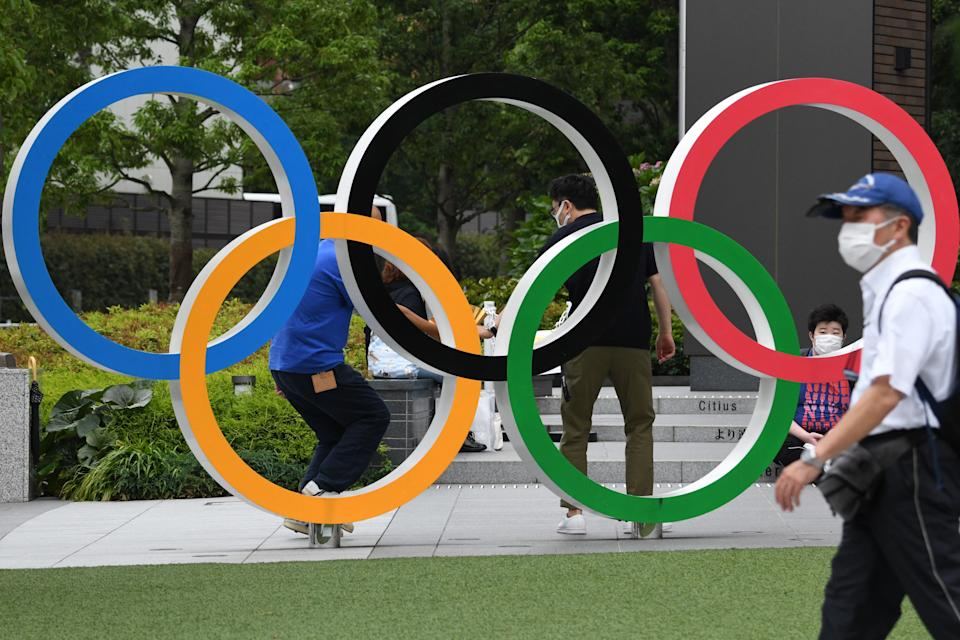 The Olympic rings is displayed near the National Stadium, main venue for the Tokyo 2020 Olympic and Paralympic Games in Tokyo on July 7, 2021, as reports said the Japanese government plans to impose a virus state of emergency in Tokyo during the Olympics. (Photo by Kazuhiro NOGI / AFP) (Photo by KAZUHIRO NOGI/AFP via Getty Images)