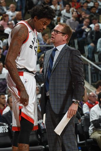 TORONTO, CANADA - APRIL 17: Lucas Nogueira #92 and Assistant Coach Nick Nurse speak during the game against the Washington Wizards in Game Two of Round One of the 2018 NBA Playoffs on April 17, 2018 at the Air Canada Centre in Toronto, Ontario, Canada. (Photo by Ron Turenne/NBAE via Getty Images)