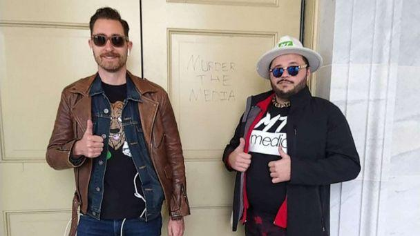 PHOTO: Nicholas DeCarlo and Nicholas Ochs pose next to a carving that says 'murder the media' during the insurrection at the Capitol, Jan. 6, 2021, in an image released by the U.S. Attorney's Office of the District of Columbia. (District of Columbia U.S. Attorney's Office )
