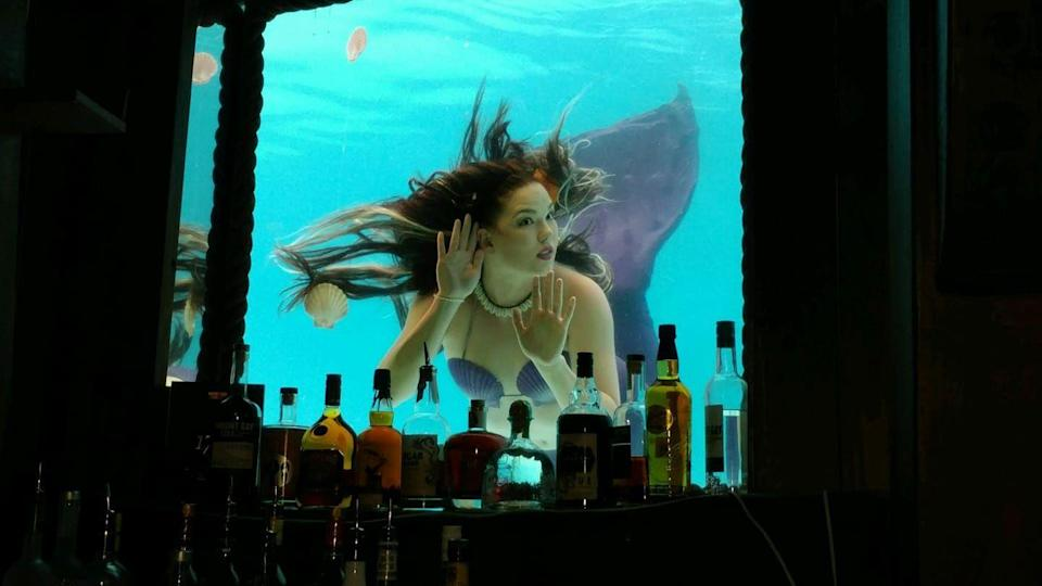 """<p><em>Ft. Lauderdale, FL</em></p><p>Ahoy! It's a pirate's paradise when you enter this nautical, shipwreck-inspired watering hole. The <a href=""""https://www.bhotelsandresorts.com/b-ocean-resort/eat-drink/wreck-bar"""" rel=""""nofollow noopener"""" target=""""_blank"""" data-ylk=""""slk:Ft. Lauderdale bar"""" class=""""link rapid-noclick-resp"""">Ft. Lauderdale bar</a> offers visitors the chance to sip on cocktails as they take in the beauty of living """"mermaids"""" as they gracefully swim past the porthole.</p><p>Photo: Facebook.com/<a href=""""https://www.facebook.com/Aquaburlesque/"""" rel=""""nofollow noopener"""" target=""""_blank"""" data-ylk=""""slk:TheWreckBar"""" class=""""link rapid-noclick-resp"""">TheWreckBar</a></p>"""