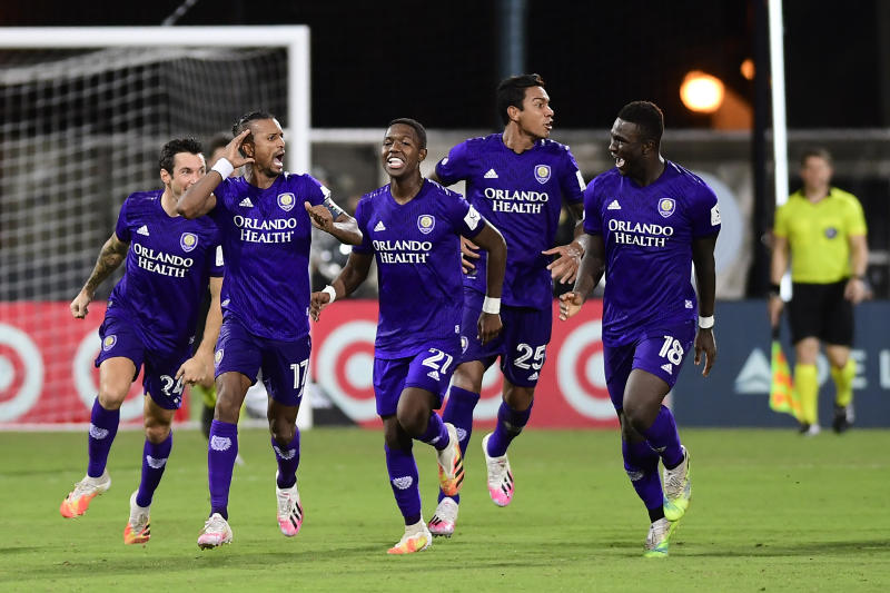 REUNION, FLORIDA - JULY 31: Nani #17 of Orlando City and teammates celebrate their victory in the penalty shoot-out over Los Angeles FC during a quarter final match of MLS Is Back Tournament between Orlando City and Los Angeles FC at ESPN Wide World of Sports Complex on July 31, 2020 in Reunion, Florida. (Photo by Emilee Chinn/Getty Images)