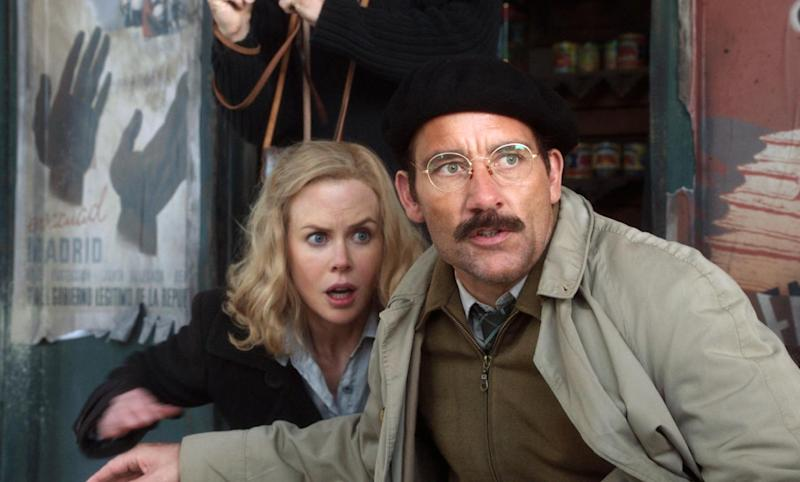 """FILE - In this file photo released by HBO, Nicole Kidman portrays Martha Gelhorn, left, and Clive Owen portrays Ernest Hemingway in a scene from the HBO film, """"Hemingway & Gellhorn.""""  The film was nominated for an Emmy award for Outstanding miniseries or movie on Thursday, July 19, 2012.  Kidman and Owen were also nominated for outstanding actress and actor in a miniseries or movie. The 64th annual Primetime Emmy Awards will be presented Sept. 23 at the Nokia Theatre in Los Angeles, hosted by Jimmy Kimmel and airing live on ABC. (AP Photo/HBO, File)"""