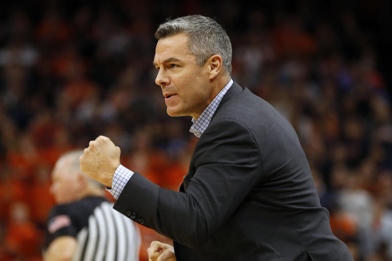 Virginia head coach Tony Bennett directs his team during the first half of an NCAA college basketball game against North Carolina in Richmond, Va., Sunday, Dec. 8, 2019. (AP Photo/Steve Helber)