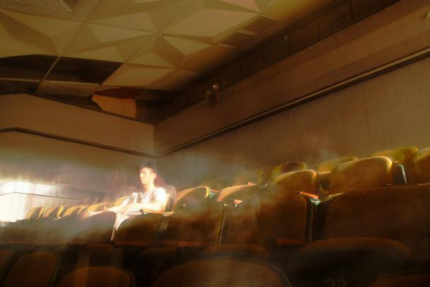 Local photographer Sim captures filmmaker Royston Tan in this ghostly shot in Queenstown Cinema (Photo courtesy of Valence Sim)