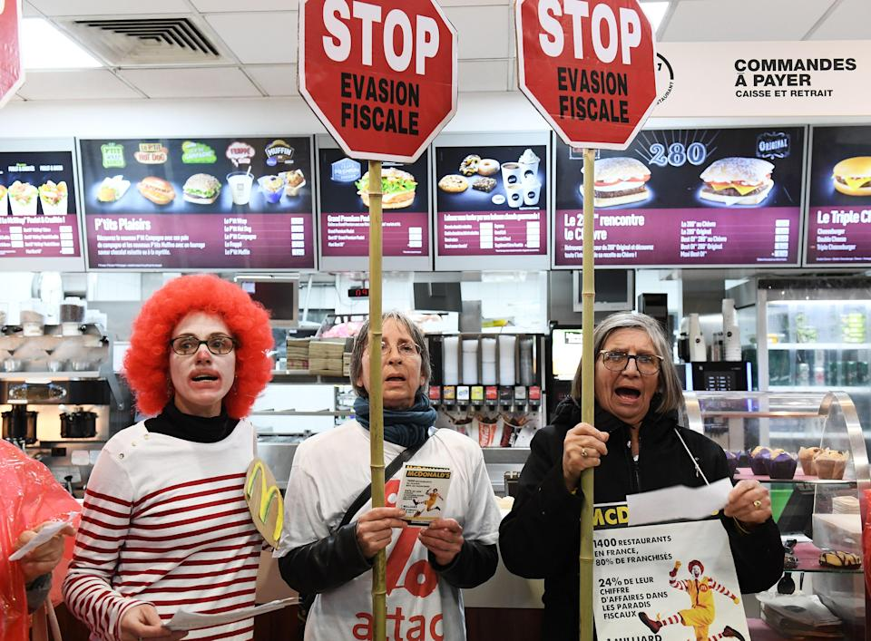 Activists protest against tax avoidance at a McDonald's in Paris (Getty)