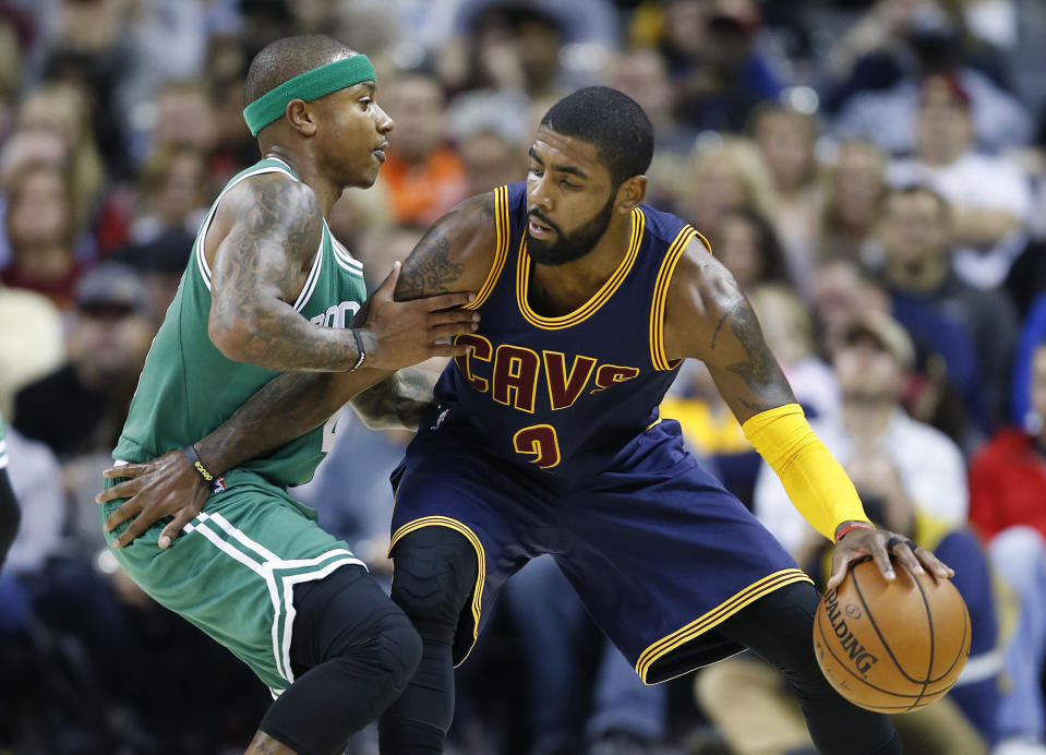 Kyrie Irving works against Isaiah Thomas during a game last November. (AP Photo/Ron Schwane)