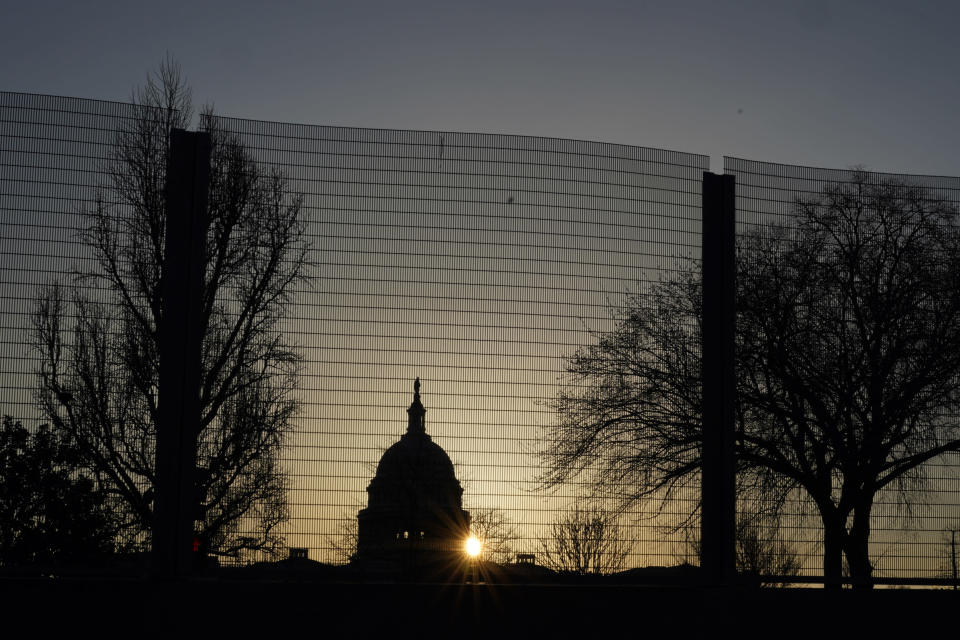 """FILE - In this March 4, 2021, file photo the Capitol dome is seen beyond a perimeter security fence at sunrise in Washington. Far right extremist groups like the Proud Boys and Oath Keepers are planning to attend a rally in September at the U.S. Capitol that is designed to demand """"justice"""" for the hundreds of people who have been charged in connection with January's insurrection, according to three people familiar with intelligence gathered by federal officials. As a result, U.S. Capitol Police have been discussing in recent weeks whether the large perimeter fence that was erected outside of the Capitol after January's riot will need to be put back up, the people said. (AP Photo/Carolyn Kaster)"""
