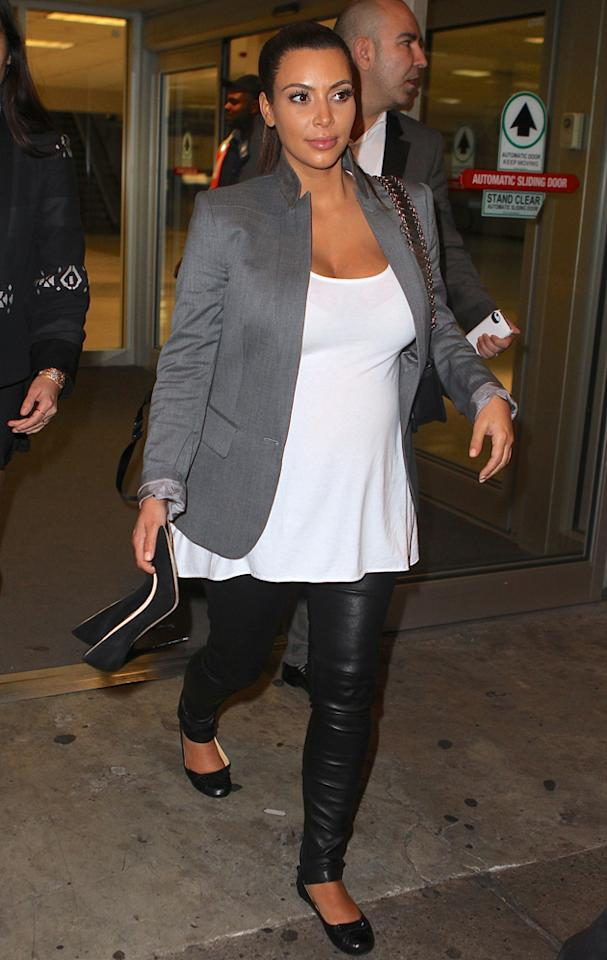 Kim Kardashian goes back to her trusty leather leggings for yet another flight. Copyright [Splash]