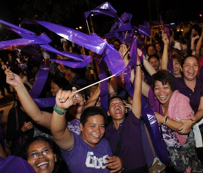 People celebrate after legislators pass a landmark birth control bill in Manila on December 17, 2012. Philippine Catholic church leaders vowed Tuesday to overturn a birth control bill after lawmakers passed legislation to make birth control more widely available