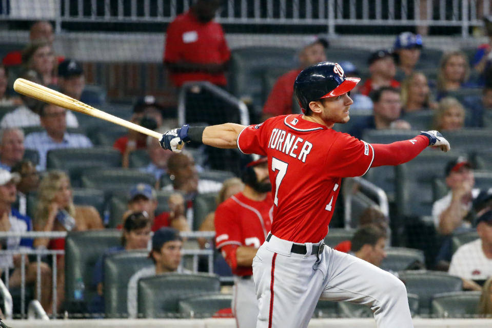 Washington Nationals shortstop Trea Turner (7) drives in a run with a double in the fifth inning of a baseball game against the Atlanta Braves Saturday, July 20, 2019, in Atlanta. (AP Photo/John Bazemore)