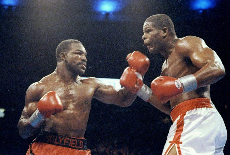 Evander Holyfield (L) was known for his resilience, which he displayed in his three fights with Riddick Bowe. (Getty Images)