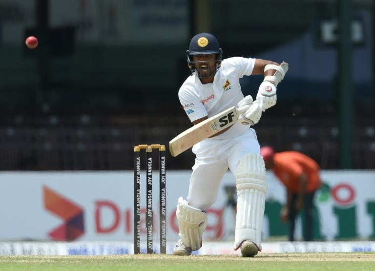 Sri Lanka batsman Dinesh Chandimal plays a shot on the first day of the second and final Test against Bangladesh in Colombo on March 15, 2017