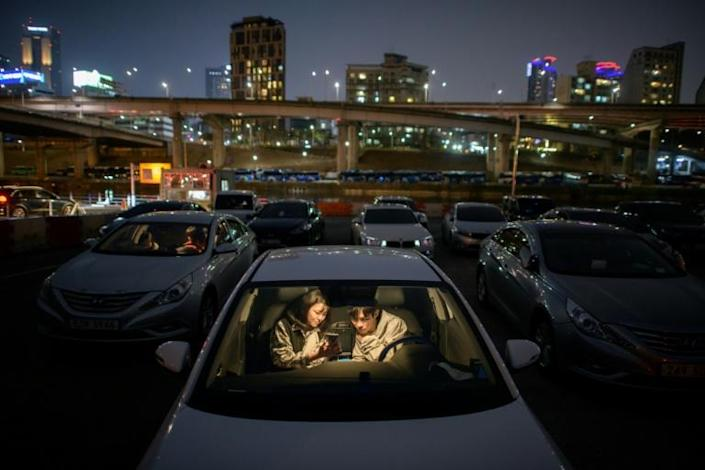 Moviegoers can enjoy a film from the comfort of their cars (AFP Photo/Ed JONES)