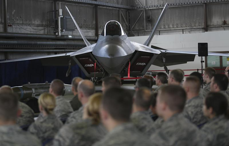 Soldiers listen in front of an U.S. Air Force F-22 Raptor fighter jet during a briefing in a hangar at the U.S. Spangdahlem Air base, Germany: REUTERS