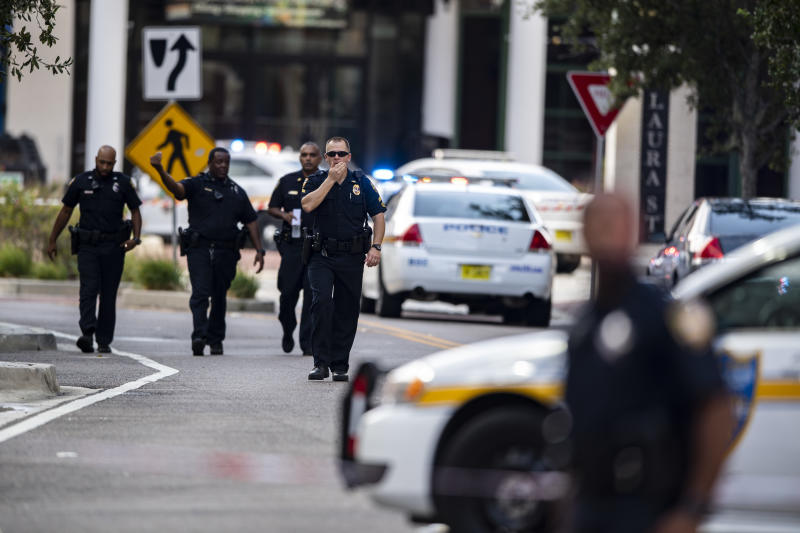 Police gather after an active shooter was reported at the Jacksonville Landing in Jacksonville, Florida, on Sunday. (AP)