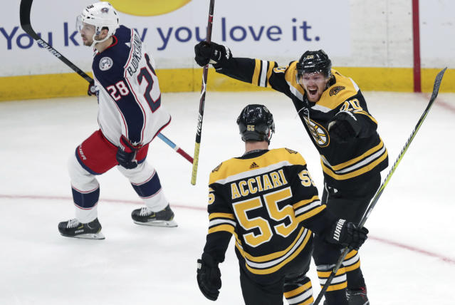 Boston Bruins center Noel Acciari (55) is congratulated by Joakim Nordstrom, right, after his goal against the Columbus Blue Jackets during the first period of Game 1 of an NHL hockey second-round playoff series, Thursday, April 25, 2019, in Boston. At left is Columbus Blue Jackets right wing Oliver Bjorkstrand (28). (AP Photo/Charles Krupa)