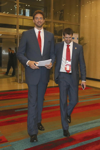 Spain's Pau Gasol, left, arrives to attend Madrid's Olympic bid presentation before the International Olympic Committee in Buenos Aires, Argentina, Saturday, Sept. 7, 2013. Madrid, Istanbul and Tokyo are competing to host the 2020 Summer Olympic Games. (AP Photo/Alexander Hassenstein, Pool)
