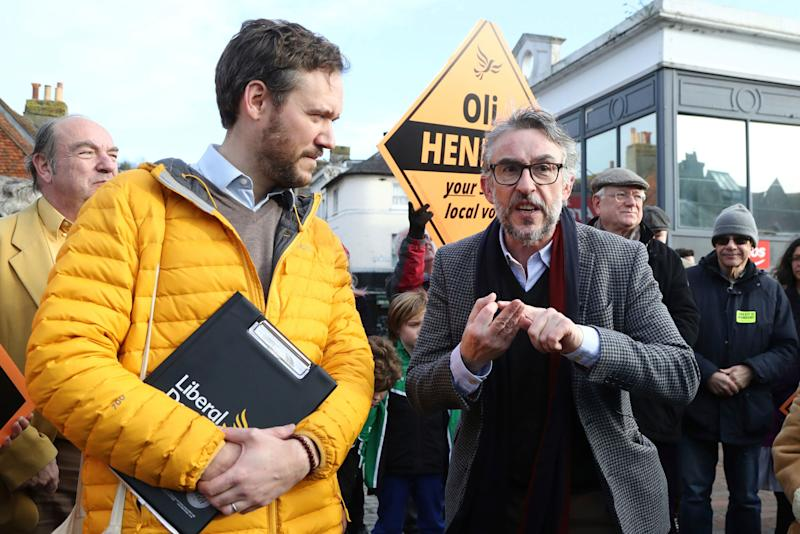 <strong>British actor Steve Coogan, right, joins Liberal Democrat candidate Oliver Henman as they canvass in the Lewes constituency, in Lewes.</strong> (Photo: ASSOCIATED PRESS)
