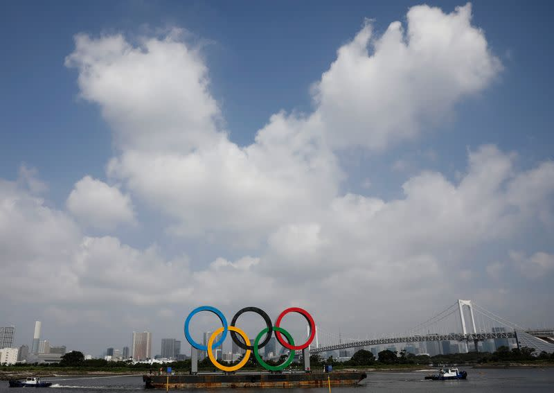 The giant Olympic rings are being temporarily removed for maintenance, amid the coronavirus disease (COVID-19) outbreak, at the waterfront area at Odaiba Marine Park in Tokyo