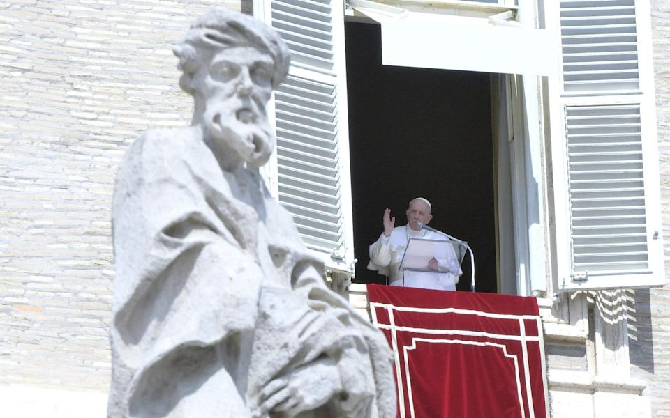 Pope Francis leads Sunday Angelus prayer from the window of his office overlooking Saint Peter's Square at the Vatican on 19 September 2021 - Claudio Peri/Shutterstock