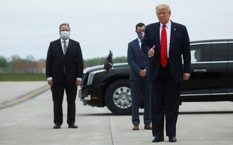 Donald Trump arrives at Detroit international airport on a visit to Michigan during the coronavirus pandemic: REUTERS